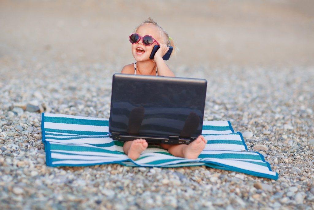 child enjoying the beach