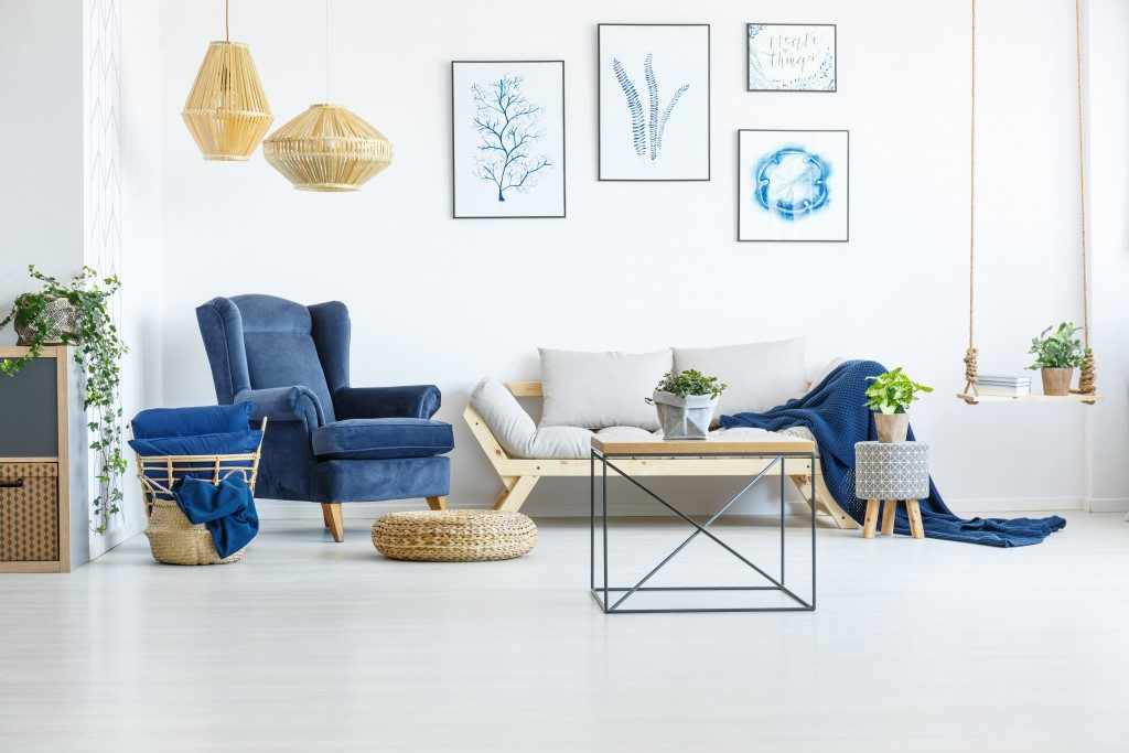 blue sofa in a white living room