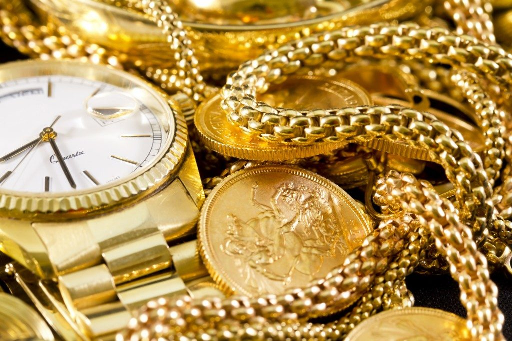gold watch and coins