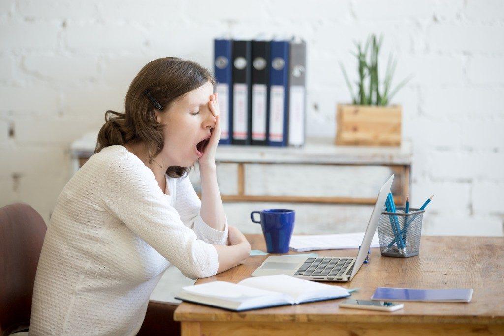 woman yawning during work