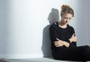 Woman looking down sad