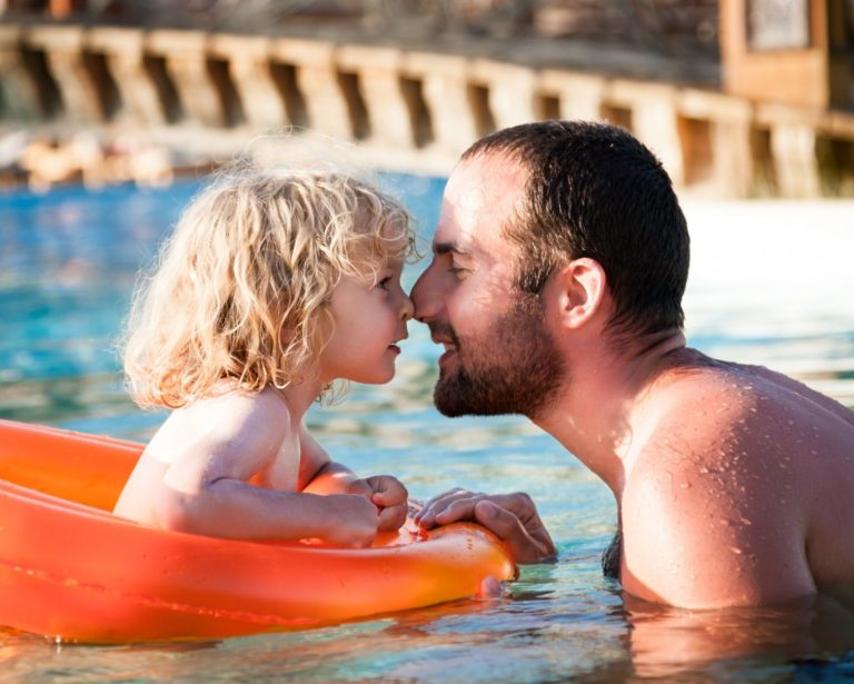 Dad and his son nose to nose in the pool