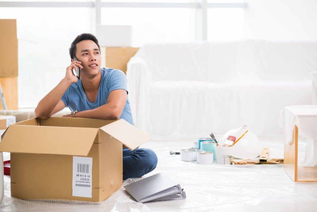 Man calling while unpacking to his new place