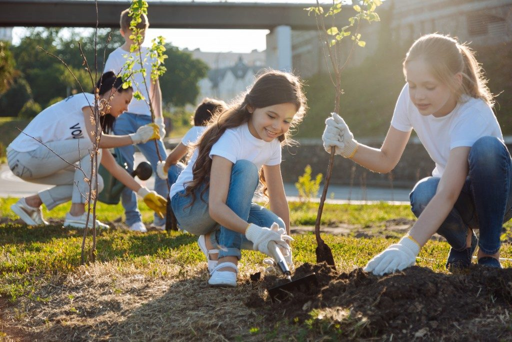 Girls planting trees