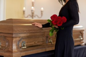 casket and mourning lady