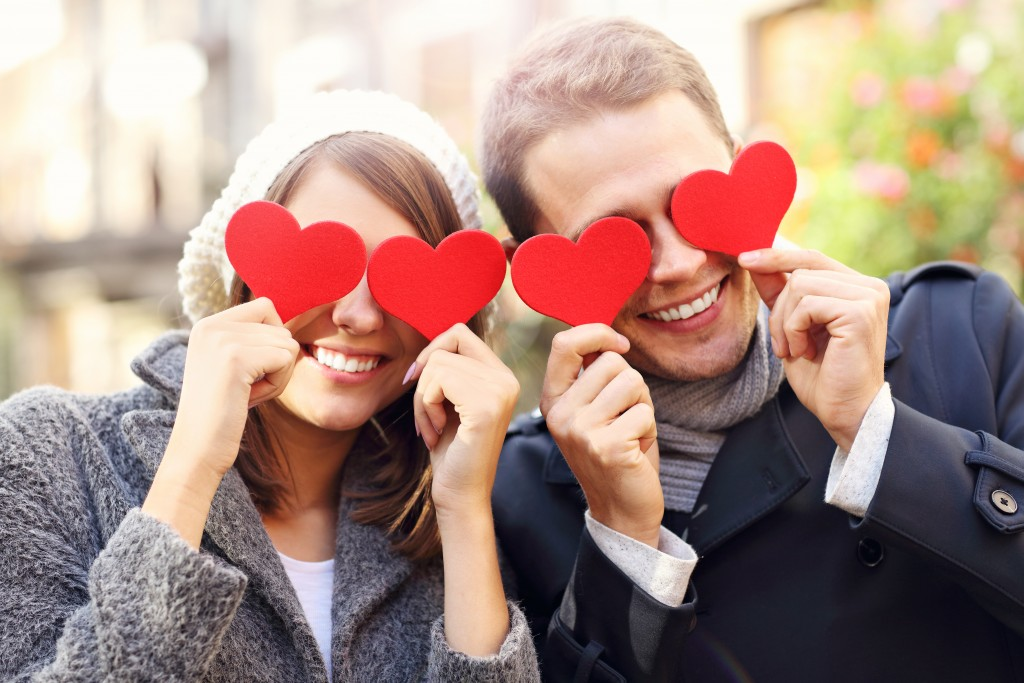 heart cutouts with couple