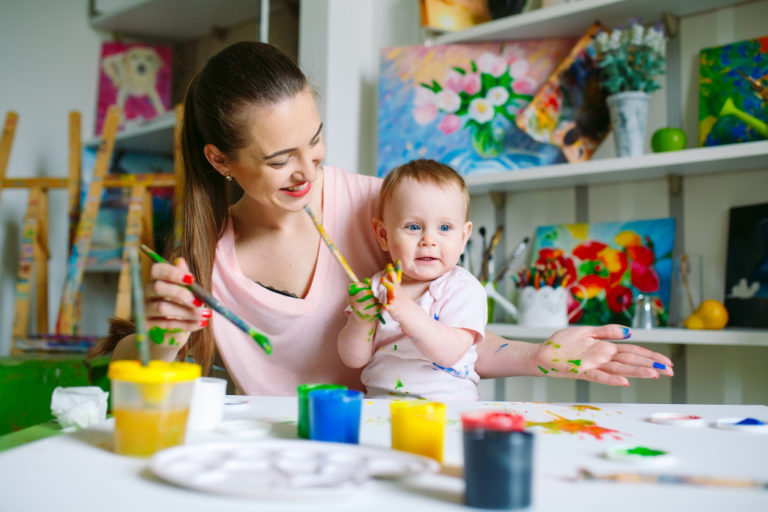 mother painting with her baby