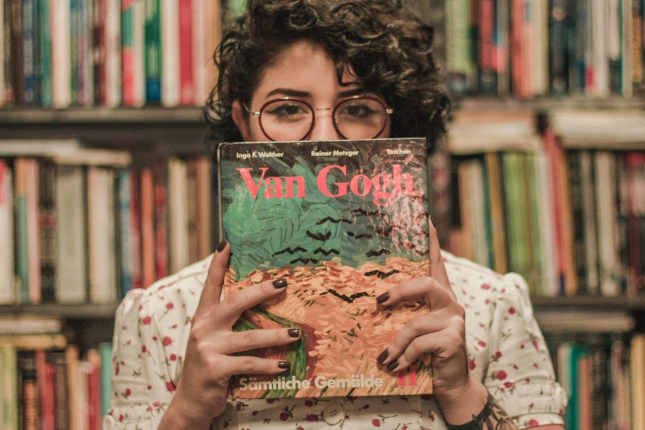 holding a Van Gogh book