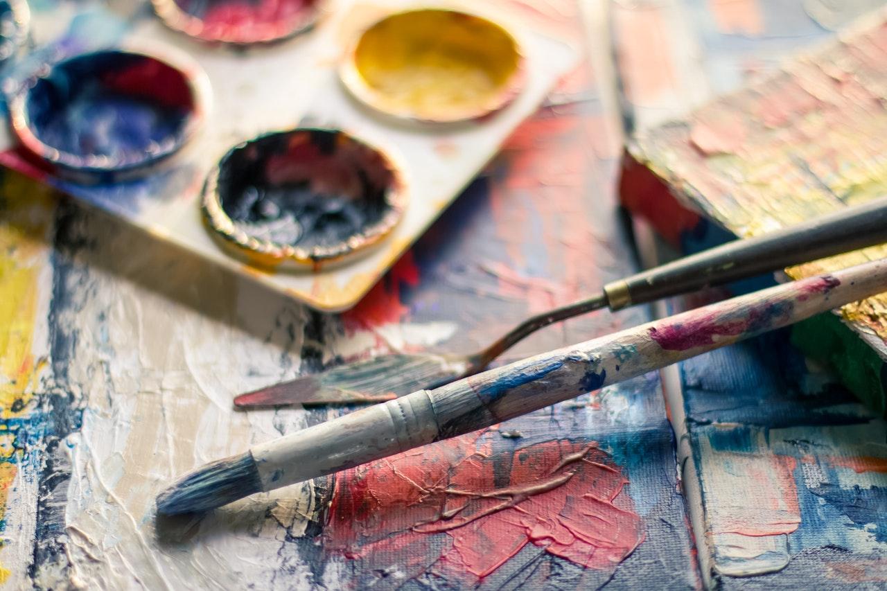 Photography of Paintbrush Near Paint Pallet