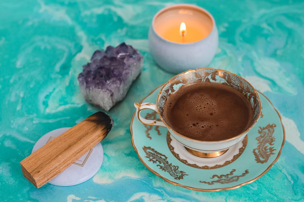 crystals with candle and tea