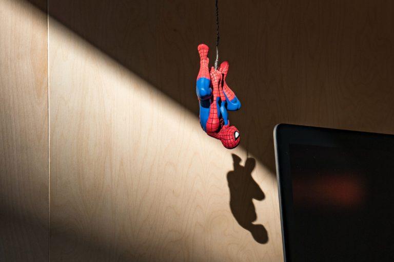 spiderman hanging upside down